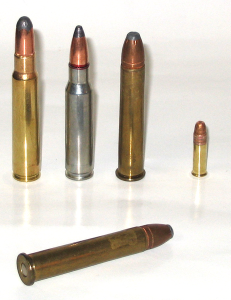 Photo of two .375 Winchester rifle cartridges with others for comparison. Left to right: 8mm Mauser, .308 Winchester, .375 Winchester, .22 Long Rifle. Foreground: .375 Winchester.